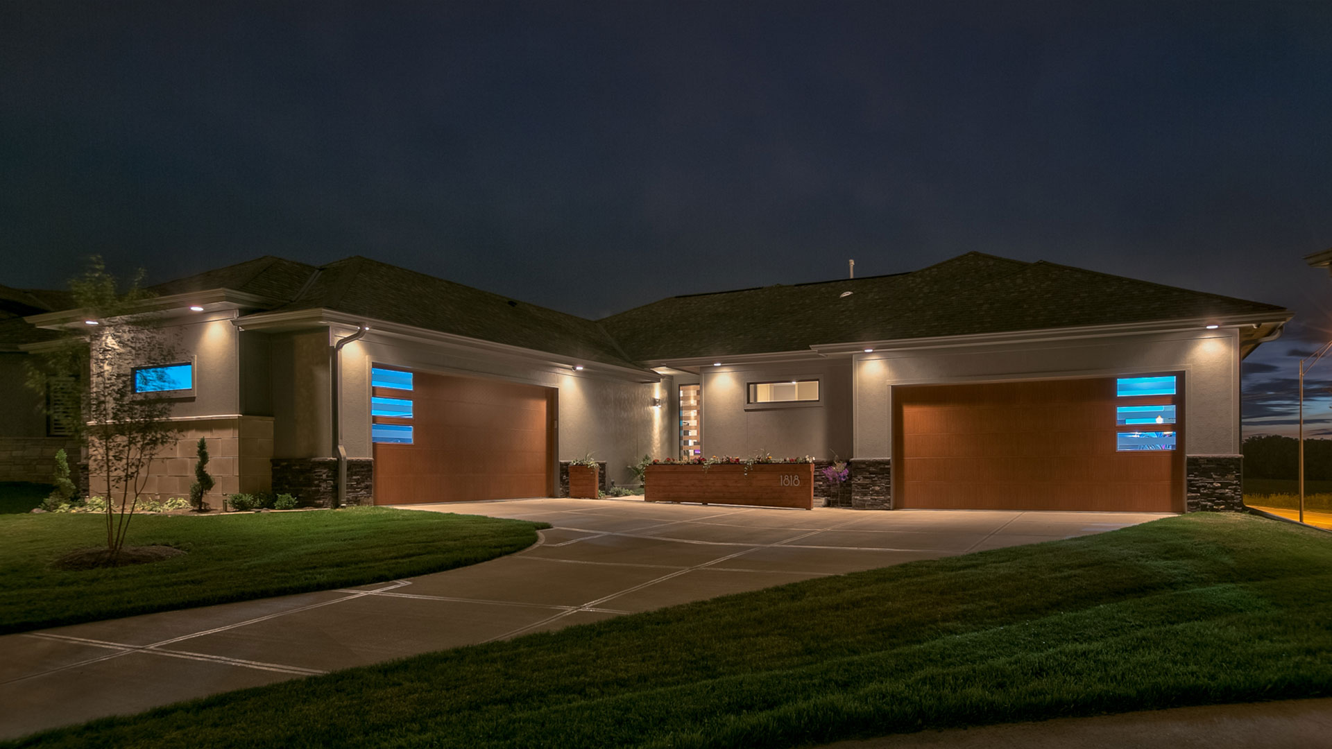 modern garage doors illuminated at night